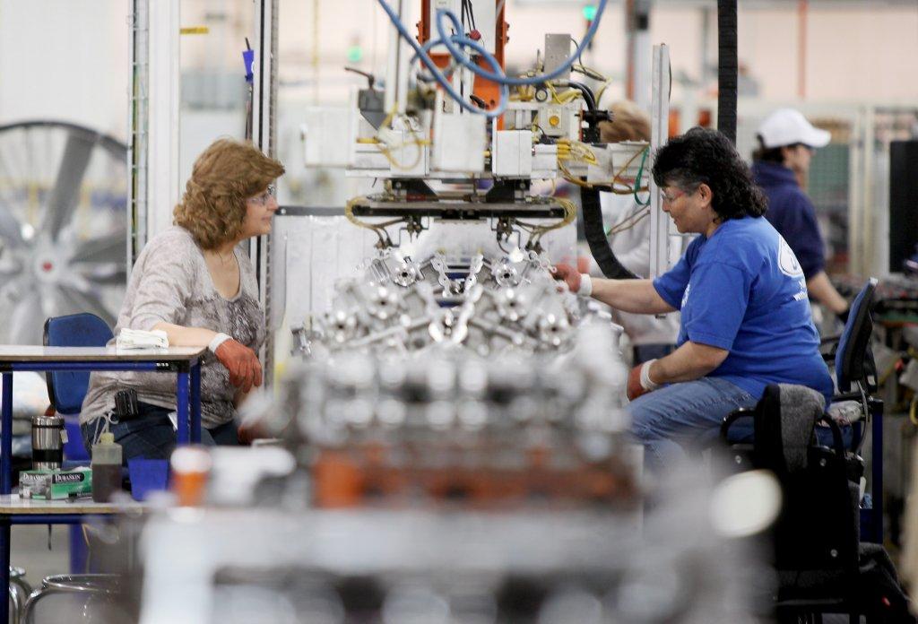 Women work on a factory line.