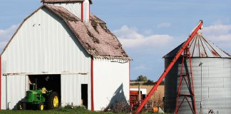 Iowa farm with barn, silo and tractor