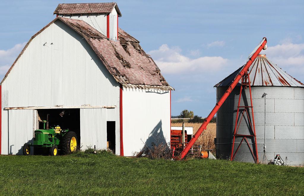 Iowa farm with barn, silo and tractor
