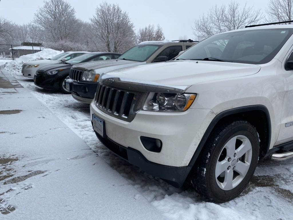 Cars parked in a snowy parking lot
