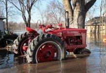 Tractor in flooded Hamburg, Iowa, 2019