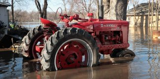 Tractor in flooded Hamburg, Iowa, 2019