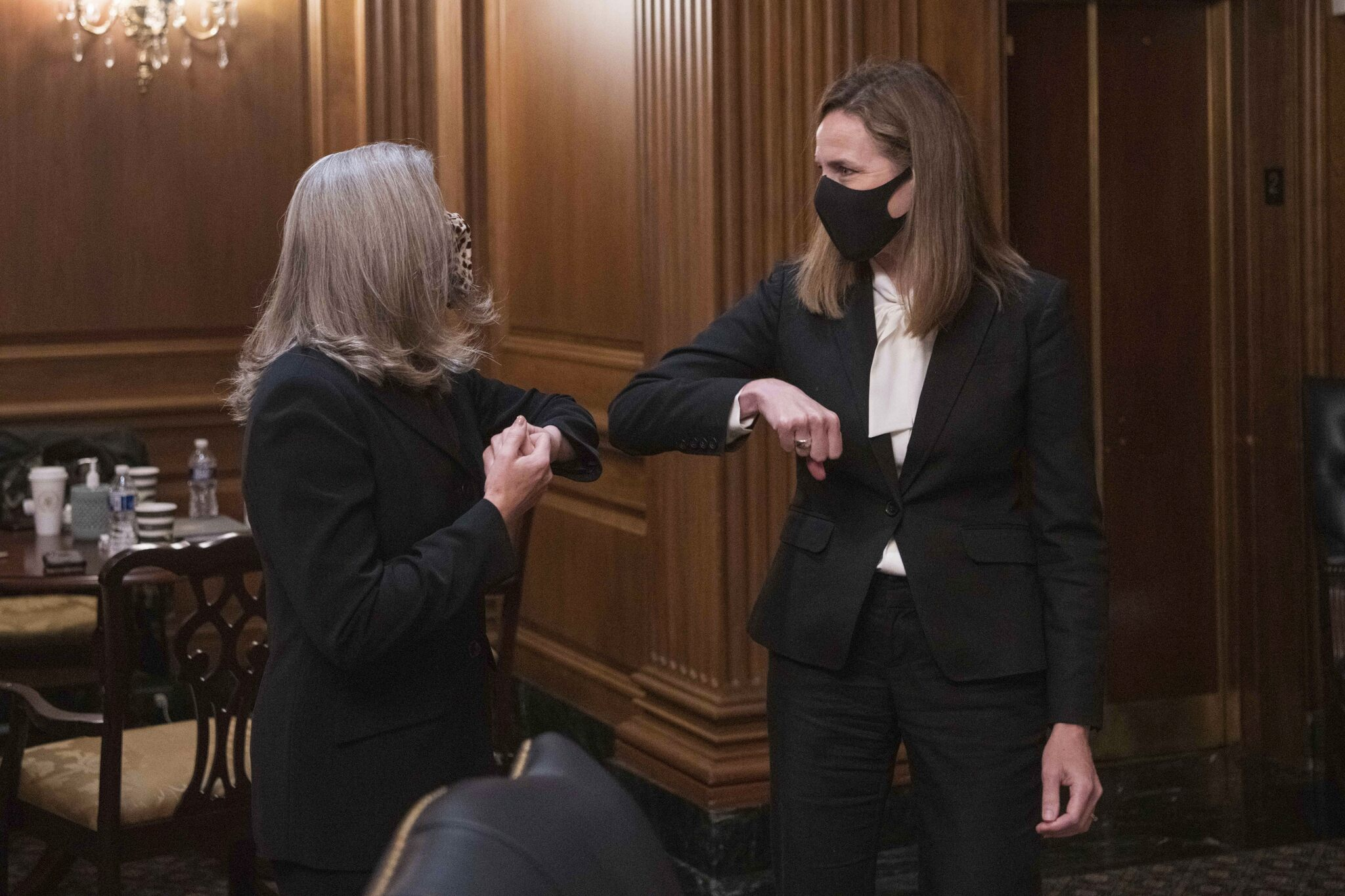 Ernst works to appeal to female voters by holding up Judge Barrett as a trailblazer like RBG